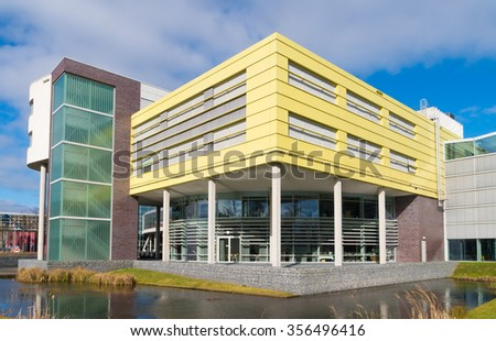 ZWOLLE, NETHERLANDS - MARCH 22, 2015: modern office building exterior. Zwolle is a very green city and counts 33 public parks. - stock photo