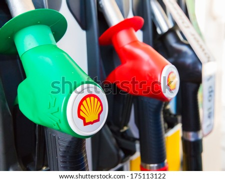 ZWOLLE, THE NETHERLANDS - FEBRUARY 3, 2014: Filling nozzles at a Shell gas station.  - stock photo