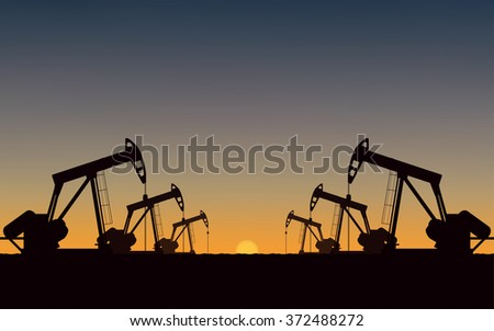 Silhouette Oil pumps at oil field with sunset sky background (vector) - stock vector