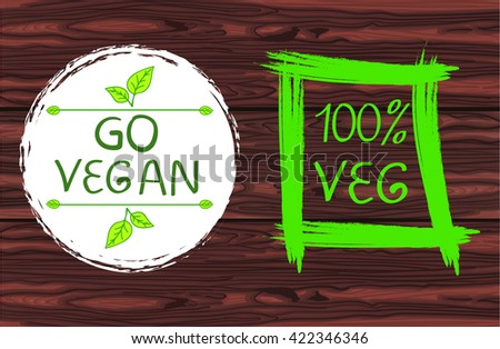 100% VEG and Go vegan handwritten text in square hand drawn frame. VECTOR green illustration on red wood background.  - stock vector