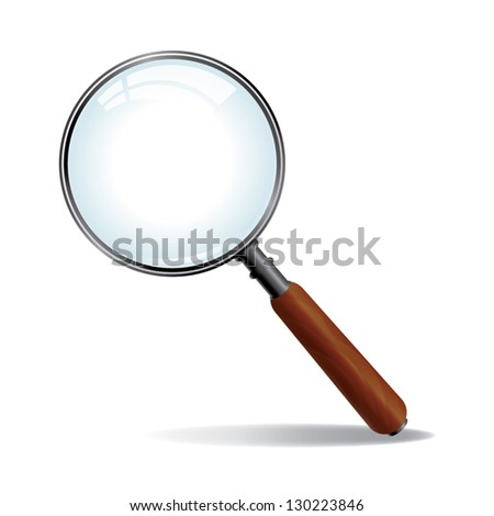 A brushed nickle metal magnifying glass with wood grained handle