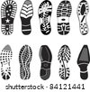 A collection of various highly detailed shoe tracks. Elegant, sporty, formal, mountain boots and child boots are included. - stock vector