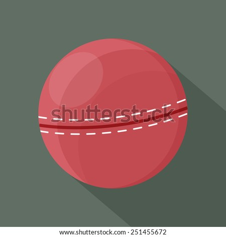 A cricket ball with shadow.