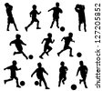A group of boys in silhouettes playing soccer or football - stock photo