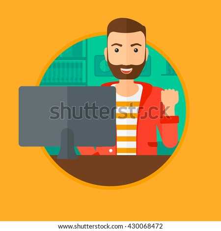A hipster man with the beard sitting in office and expressing great satisfaction while looking at computer monitor. Vector flat design illustration in the circle isolated on background. - stock vector
