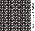 A repeating vector herringbone pattern in black and gray. - stock photo