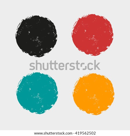A set of colored circles of paint.Red circle. Black spot. A green spot. The yellow circle