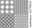A set of four monochrome geometrical patterns. White, gray grille texture in Arabic, Oriental style. A seamless vector background. - stock photo