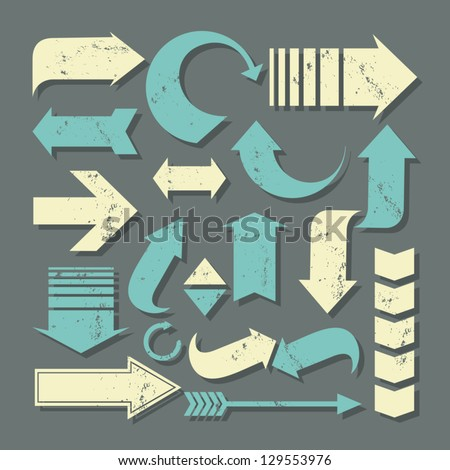 A set of grunge arrows in pastel colors. - stock vector