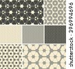 a set of 7 hexagon based, coordinated, seamless patterns, in a grey neutral color palette. - stock vector