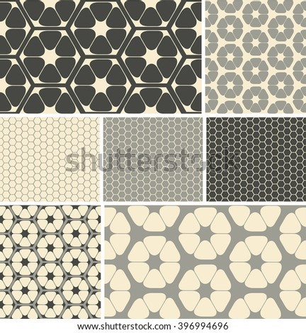 a set of 7 hexagon based, coordinated, seamless patterns, in a grey neutral color palette.