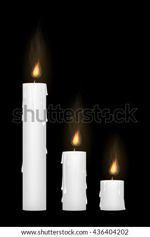 a white candle on a black blackground