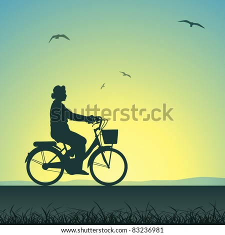 A Woman on a Bicycle in Silhouette