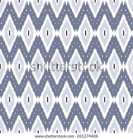 Abstract background. Ikat seamless pattern for textile, wallpaper, card. Vector illustration. - stock vector