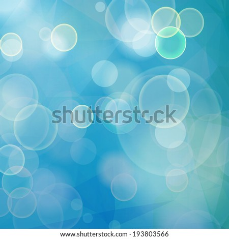 Abstract blue bokeh Lights Festive background with bubbles and triangular polygons