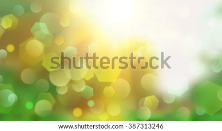 Abstract blurred background with bokeh effect in green colors
