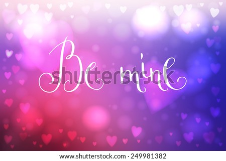 Abstract smooth blur blue and pink background with heart-shaped lights over it and hand written Valentine's day words.