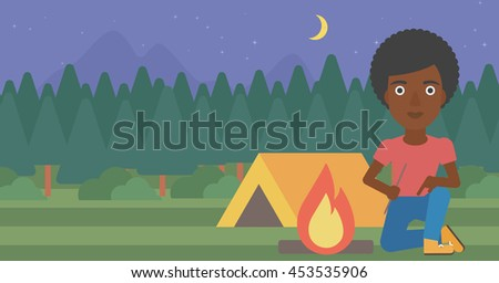 African-american woman kindling campfire on the background of camping site with tent. Tourist relaxing near campfire. Woman sitting near campfire. Vector flat design illustration. Horizontal layout. - stock vector