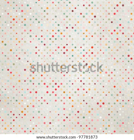 Aged and worn paper with polka dots. And also includes EPS 8 vector
