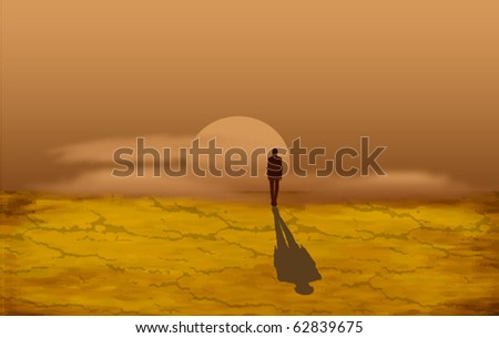 Alone man in the desert at the sunset