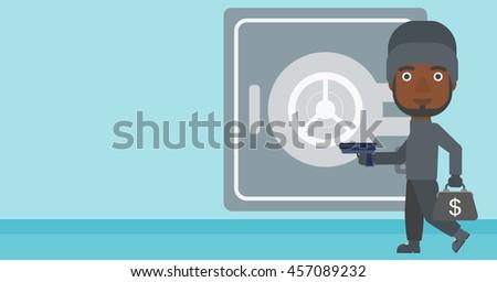 An african-american burglar in mask near the big safe door. Burglar holding hand gun and a bag with dollar sign. Thief stealing money. Vector flat design illustration. Horizontal layout. - stock vector