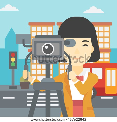 An asian young female cameraman looking through movie camera on a tripod. Young woman with professional video camera shooting in the city. Vector flat design illustration. Square layout. - stock vector