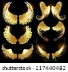 Arts painted, gold angel wings on a black background. - stock vector