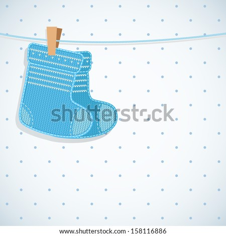 Baby boy shower card. Knitted socks on light background. Arrival card with place for your text. - stock vector