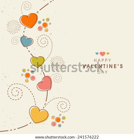 Beautiful greeting card decorated by colorful hearts and floral design for Happy Valentine's Day celebration.