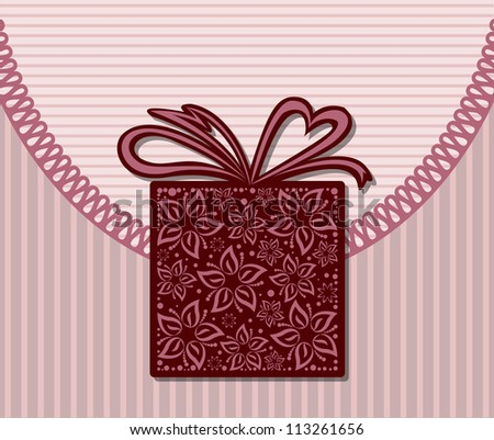 beautiful stylized box with a bow on a striped background
