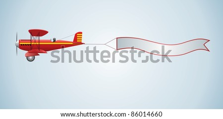 Biplane aircraft pulling advertisement banner
