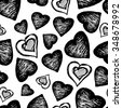 Black and white pattern of the shaded hearts of different sizes. Isolated. Seamless pattern of ink elements. Hatched black and white hearts. Love.  - stock vector