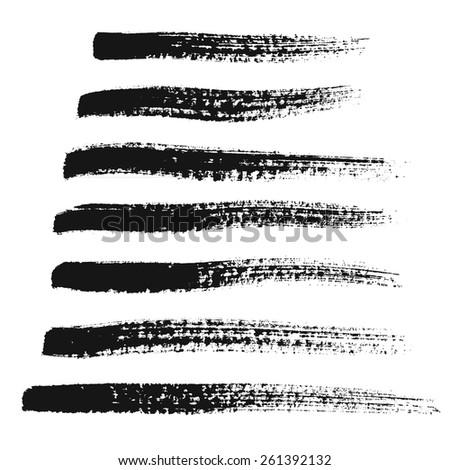 Black painted brush strokes set isolated on white background. Grunge paintbrushes collection. Strips design elements. Distress texture effect. Torn edges with splashes and splatters. For frames.