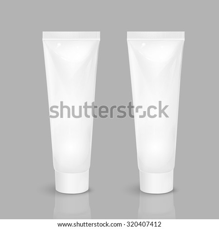 blank cosmetic tubes isolated on grey background