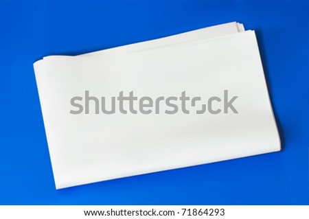 blank empty folded newspaper isolated on blue background with shadow