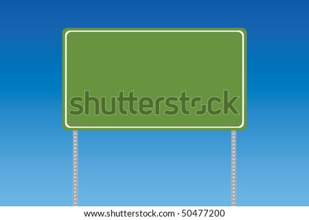 Blank green road sign on a blue graduated sky