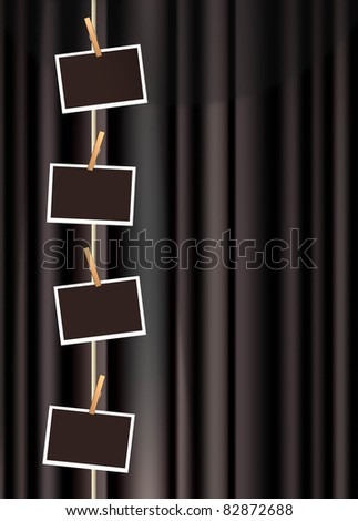 blank photo frames hanging from a clothes line on a black curtain - stock vector