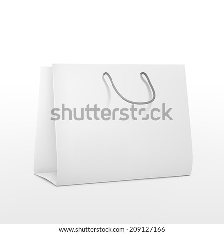 blank shopping paper bag isolated on white background
