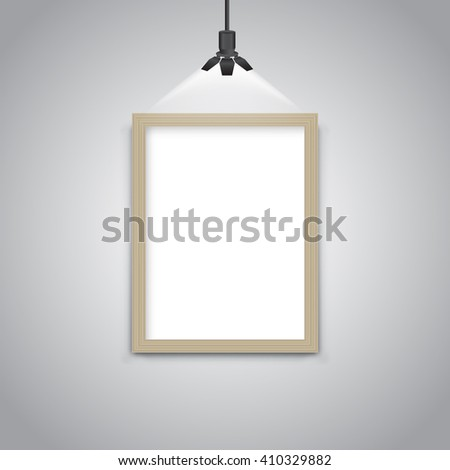 Blank wooden picture frame under light lamp - stock vector