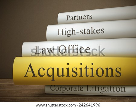 book title of acquisitions isolated on a wooden table over dark background - stock vector