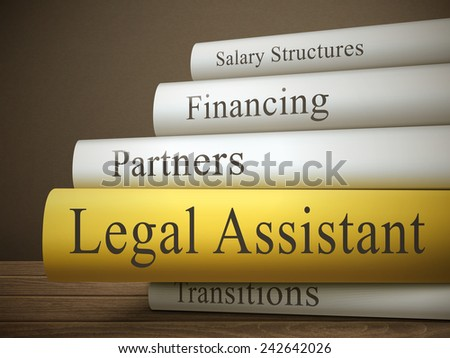 book title of legal assistant isolated on a wooden table over dark background - stock vector