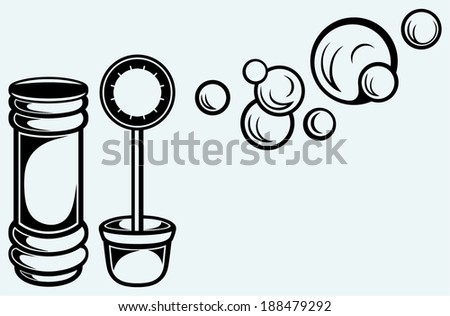 Bottle and soap bubbles. Isolated on blue background