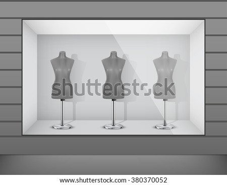Boutique display window with mannequins - stock vector