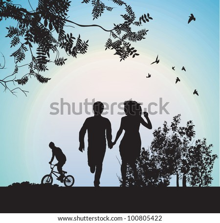 boy and girl running through the park holding hands