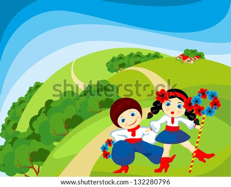 Boy with a girl dancing on the lawn on a sunny day