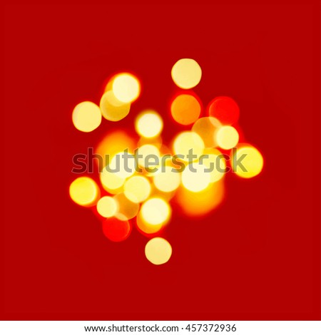 Bright yellow lights on vivid red background. Perfect for holiday greeting cards and backgrounds.