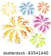 Brightly colorful vector fireworks isolated on white background - stock photo