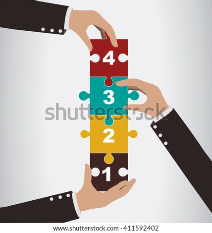 Business people help to assembly vertical puzzle with teamwork concept