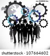 Business people with gears and world map - stock photo