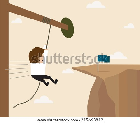 Businessman hanging on the rope reaching to the goal